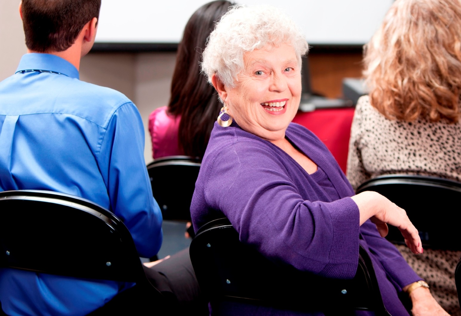 Real People:  Senior Adult Business Woman Presentation Small Group